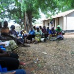 CHWs in a monthly meeting